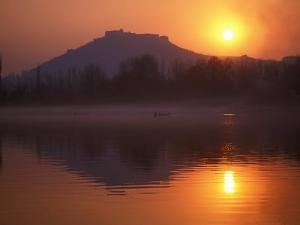 Fishermen Make their Way Home in Canoes as the Sun Sets over Nigeen Lake, Srinagar, Kashmir by David Pickford