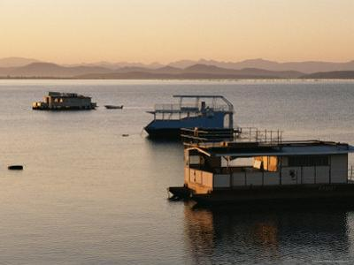 Houseboats at Dawn at Cutty Sark Hotel Marina, Lake Kariba, Zimbabwe, Africa by David Poole