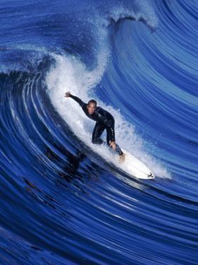 Surfer Riding a Wave by David Pu'u