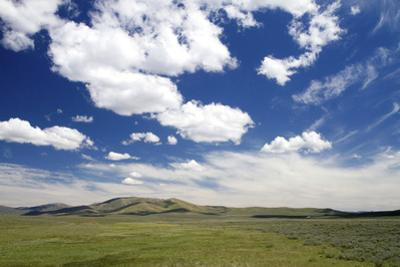 Cumulus Clouds and Blue Sky over Green Fields Near Pine, Idaho, USA