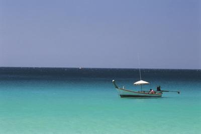 Thailand, Phuket Province, Long Tail Boat Off in Midst of Sea