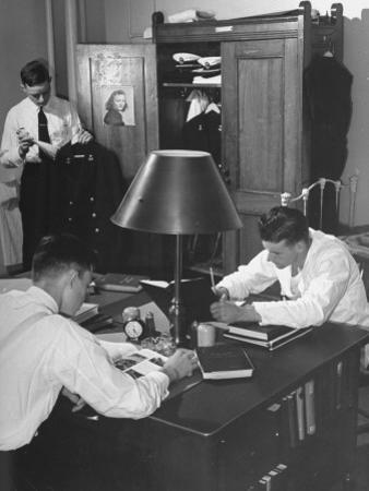 A View of Cadets at the Annapolis Naval Academy Studying in their Dorm Room by David Scherman
