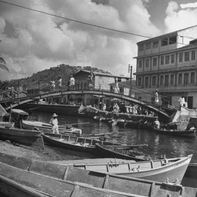 Bridge Spanning River in Middle of Town on the Island of Martinique by David Scherman