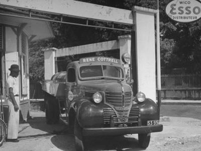 Car Sitting at a Gas Station on the Island of Martinique by David Scherman