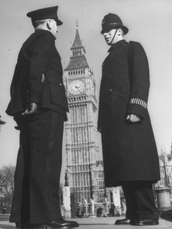 Chief Inspector of Metropolitan Police Stopping for Word with Police Constable in Parliament Square by David Scherman