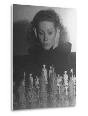 Close Up of Danielle Darrieux Looking at Chess Pieces by David Scherman