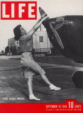 Jessie Woods Starting Private Plane at Memphis Airport, Flight Across America, September 16, 1940 by David Scherman