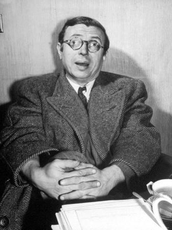 Philosopher Writer Jean Paul Sartre Making a Difficult Point, with His Eyes Going in Two Directions by David Scherman