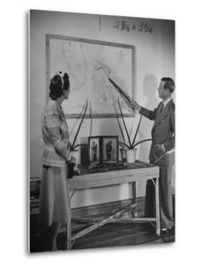 The Duke of Windsor Showing His Wife an Island on the Map by David Scherman