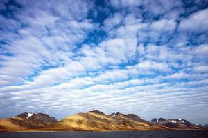 Arctic, Isfjorden. Herringbone Clouds Give Rise to a Striking Light Play on the Land Below by David Slater