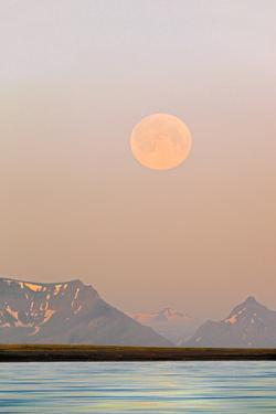 Arctic, Svalbard, Longsfjorden. Moonrise Rises Through Dust at Midnight by David Slater