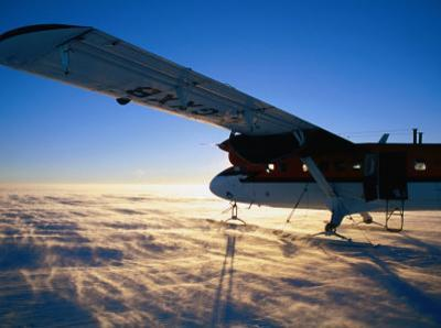 Twin-Otter Aircraft on Snow, Antarctic Plateau, Antarctica by David Tipling