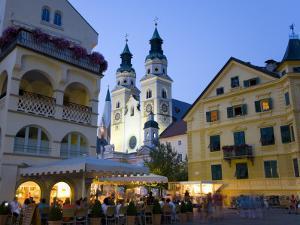 Alfresco Dining in Piazza Del Duomo Beneath Illuminated Bressanone (Brixen) Cathedral by David Tomlinson