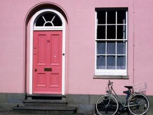 Bicycle Leaning Against Pink House, Oxford, Oxfordshire, England by David Tomlinson