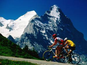 Cyclists in Front of Eiger and Snow-Covered Monch, Grosse Scheidegg, Grindelwald, Bern, Switzerland by David Tomlinson