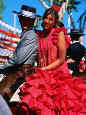 Feria de Abril Horseman with Girl in Traditional Dress, Sevilla, Andalucia, Spain by David Tomlinson