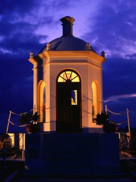 Harbourside Shrine at Puerto Banus Illuminated Against the Evening Sky, Marbella, Andalucia, Spain by David Tomlinson