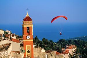 Paraglider Soaring past Tower of Colourful Village Church, Alpes-Maritimes, Roquebrune, Provence-Al by David Tomlinson