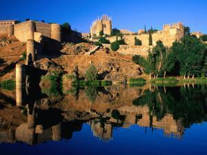 The Monastery of San Juan De Los Reyes Reflected in the River Tagus, Toledo, Spain by David Tomlinson