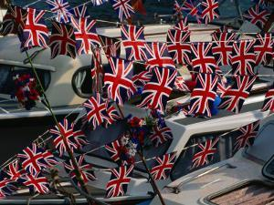 Union Jacks Festooned Over Boats at the Maidstone River Festival, Kent, England by David Tomlinson