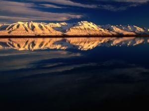Ben Ohau Range Reflected in Tekapo Canal, Canterbury, New Zealand by David Wall