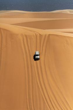Car Descending a Sand Dune, Namib-Naukluft National Park, Namibia by David Wall