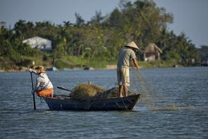 Fishing from boat on Thu Bon River, Hoi An, Vietnam by David Wall