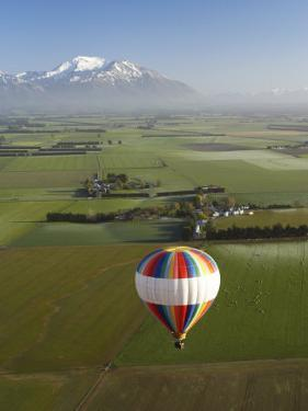 Hot-Air Balloon near Methven with Mountains in Distance, New Zealand by David Wall
