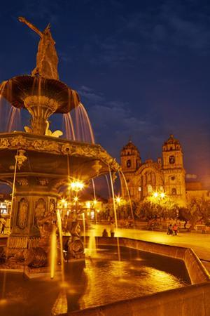 Inca statue, fountain, and Iglesia de la Compania at night, Plaza de Armas, Cusco, Peru by David Wall