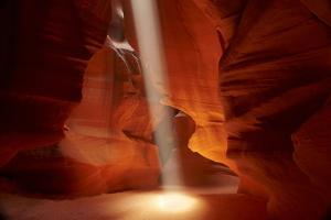 Navajo Nation, Shaft of Light and Eroded Sandstone in Antelope Canyon by David Wall
