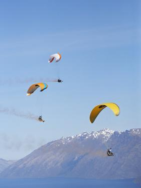 Paragliders Over Mountains, Queenstown, South Island, New Zealand by David Wall
