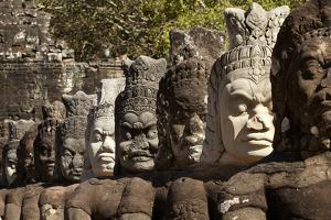 Row of Statues of Asuras on South Gate Bridge across Moat to Angkor Thom, Siem Reap by David Wall