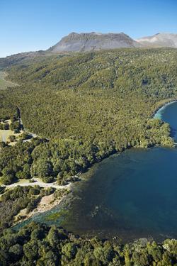 Te Tapahoro Bay, Lake Tarawera flowing into Tarawera River, and Mt Tarawera, N. Island, New Zealand by David Wall