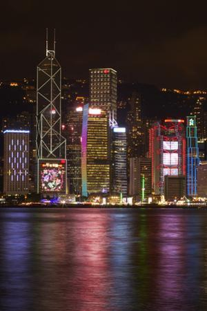 Victoria Harbor and light show on skyscrapers, Central, Hong Kong, China by David Wall