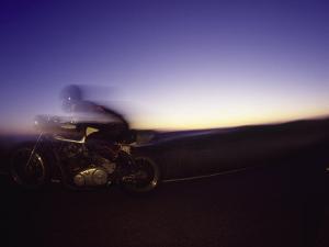 Blurred Motion of Man on Motorcycle by David Wasserman
