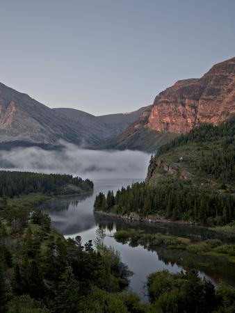 https://imgc.allpostersimages.com/img/posters/dawn-at-swiftcurrent-creek-glacier-national-park-montana-usa_u-L-PFN9NK0.jpg?p=0