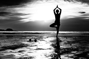 Black And White Picture: Young Woman Practicing Yoga On The Beach At Sunset by De Visu