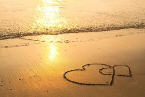 Hearts Drawn on the Sand of a Beach, Soft Wave of the Sea. by De Visu