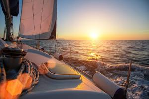 Sailing Ship Luxury Yacht Boat in the Sea during Amazing Sunset. by De Visu