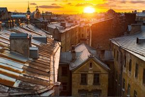 View over the Rooftops of the Historic Center of St. Petersburg, Russia during an Amazing Sunset. by De Visu