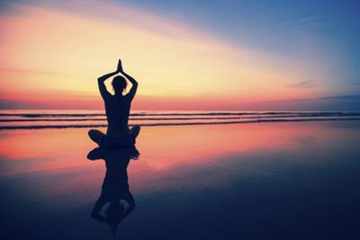 Woman Practicing Yoga on the Sea Beach at Surrealistic Sunset. by De Visu