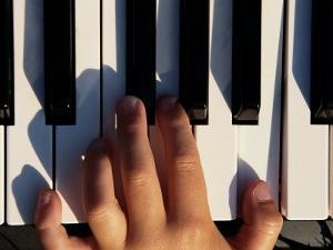Hand Playing the Piano by Dean Berry