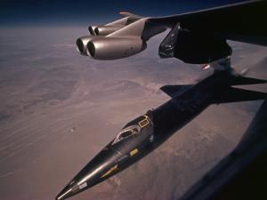 An X-15 rocket plane drops free of a B-52 by Dean Conger