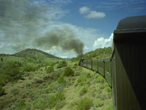 A Train is Seen Approaching Osier, Colorado, August 7, 2005 by Deborah M. Baker