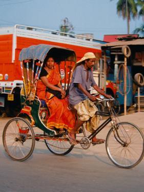 Indian Man in Bicycle Rickshaw, India by Dee Ann Pederson