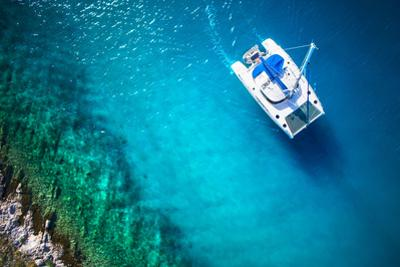 Amazing View to Yacht Sailing in Open Sea at Windy Day. Drone View - Birds Eye Angle by dellm60
