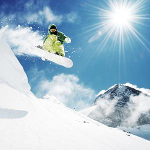 Snowboarder At Jump Inhigh Mountains At Sunny Day by dellm60