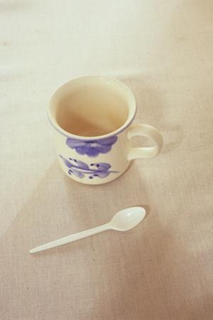 Small Mug and Plastic Spoon