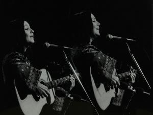 American Folk Musician Julie Felix Performing at the Forum Theatre, Hatfield, Hertfordshire, 1979 by Denis Williams