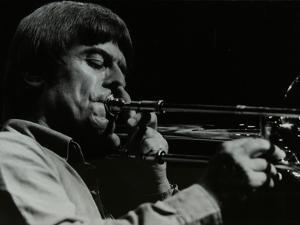 American Trombonist Bill Watrous Playing at the Forum Theatre, Hatfield, Hertfordshire, 1982 by Denis Williams